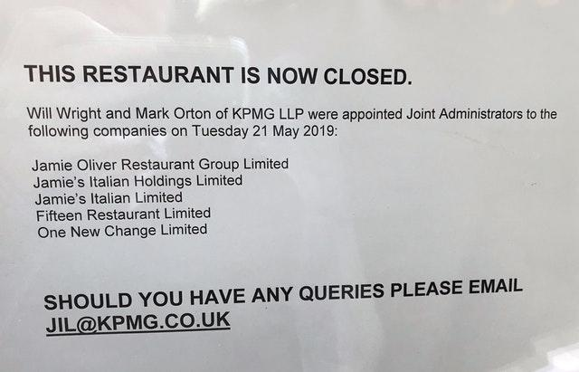 A sign in the window of a Jamie's Italian restaurant