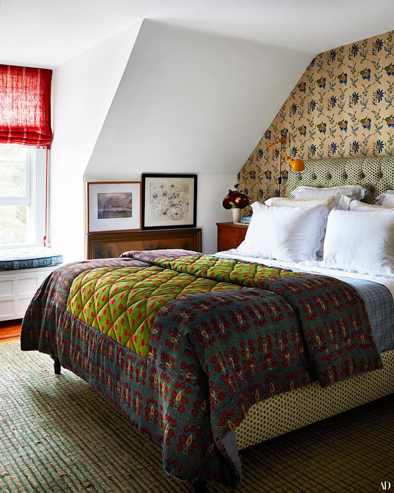 In the master bedroom, a Lisa Fine textiles linen covers a custom bed by RP Miller. Custom coverlet by RP Miller; Schweitzer linens; Sister Parish wall covering.