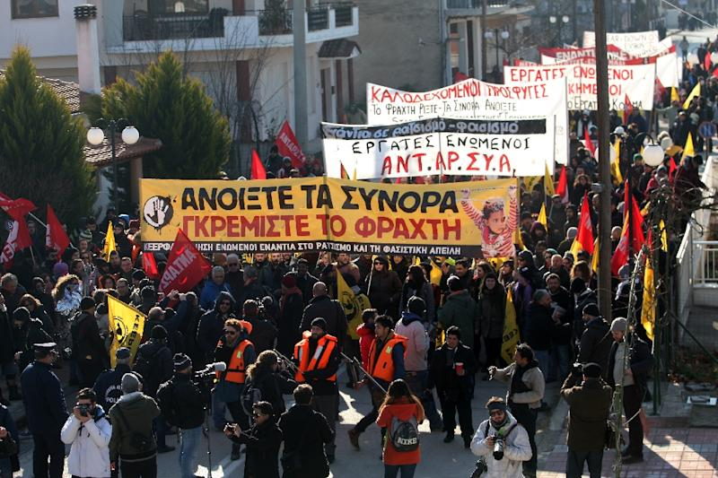 People take part in a pro-migrant protest march in the village of Kastanies, north-east Greece on January 24, 2016 against the security fence on the Turkey border intended to stop the flow of migrants