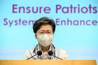 Hong Kong's pro-Beijing leader Carrie Lam was swift to applaud the plan to rewrite the electoral landscape of her city
