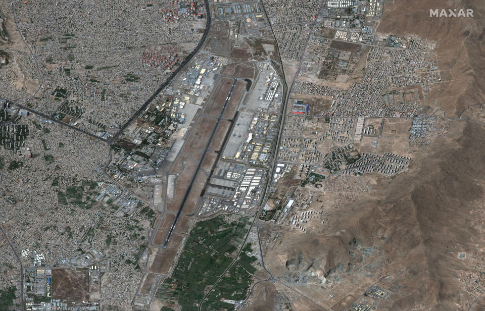 In this satellite image provided by Maxar Technologies, overview of Hamid Karzai International Airport, in Kabul, Afghanistan on Friday, Aug. 27, 2021. Evacuation flights from Afghanistan have resumed with new urgency, a day after two suicide bombings targeted the thousands of people desperately fleeing a Taliban takeover and killed dozens. (Satellite Image ©2021 Maxar Technologies via AP)