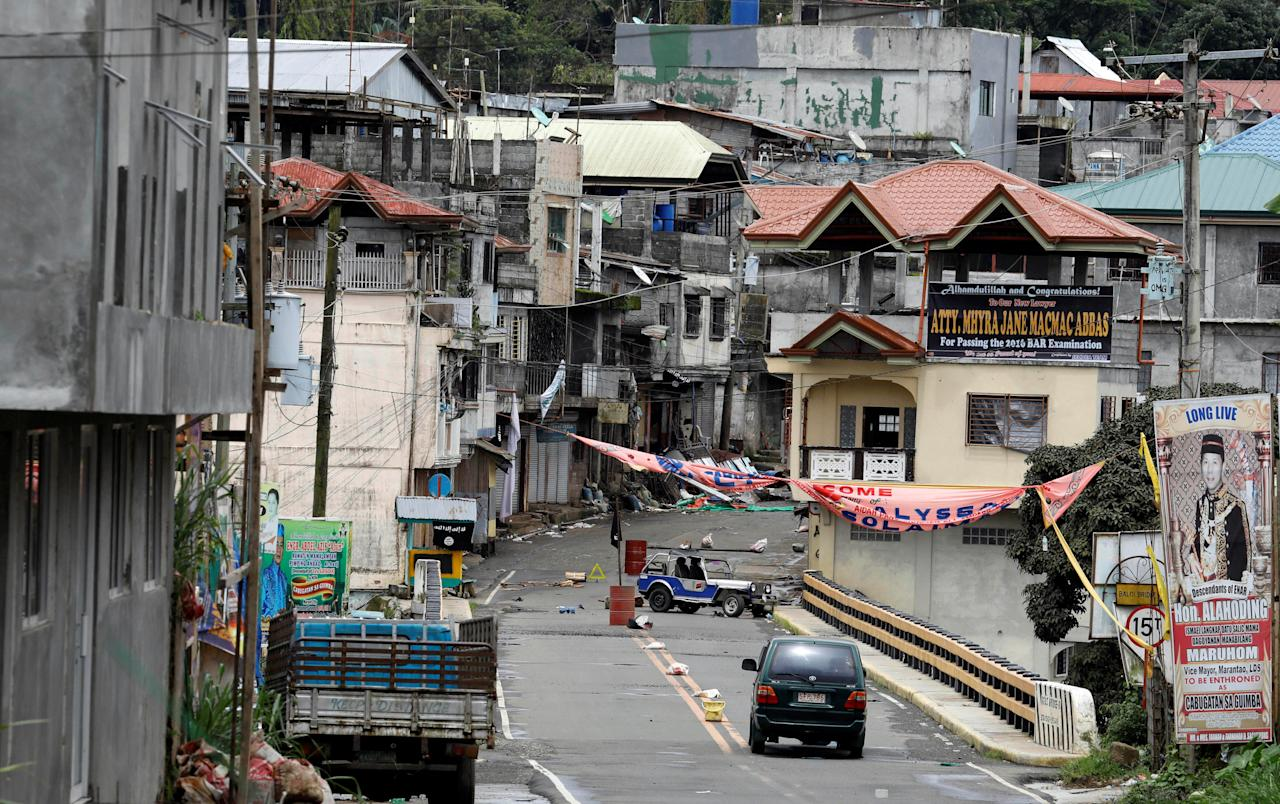 A view of the Maute group stronghold with an ISIS flag in Marawi City in southern Philippines May 29, 2017. REUTERS/Erik De Castro