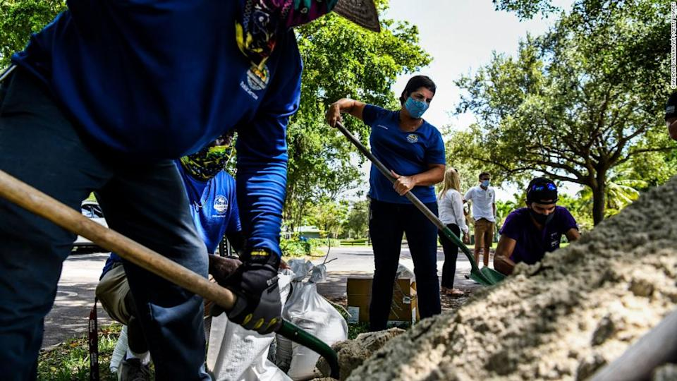 """<p>Sandbags are filled for distribution to residents of Palmetto Bay near Miami, Florida, on July 31, 2020.</p><div class=""""cnn--image__credit""""><em><small>Credit: Chandan Khanna/AFP/Getty Images / Getty</small></em></div>"""
