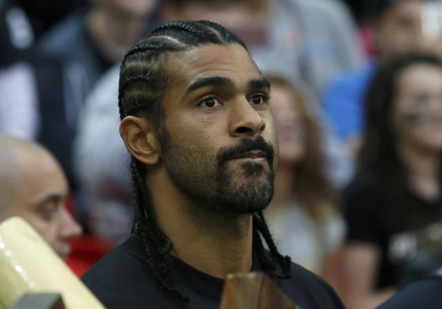 English boxer David Haye stands on the sideline before the Minnesota Vikings met the Pittsburgh Steelers in their NFL football game at Wembley Stadium in London, September 29, 2013. REUTERS/Suzanne Plunkett (BRITAIN - Tags: SPORT FOOTBALL)