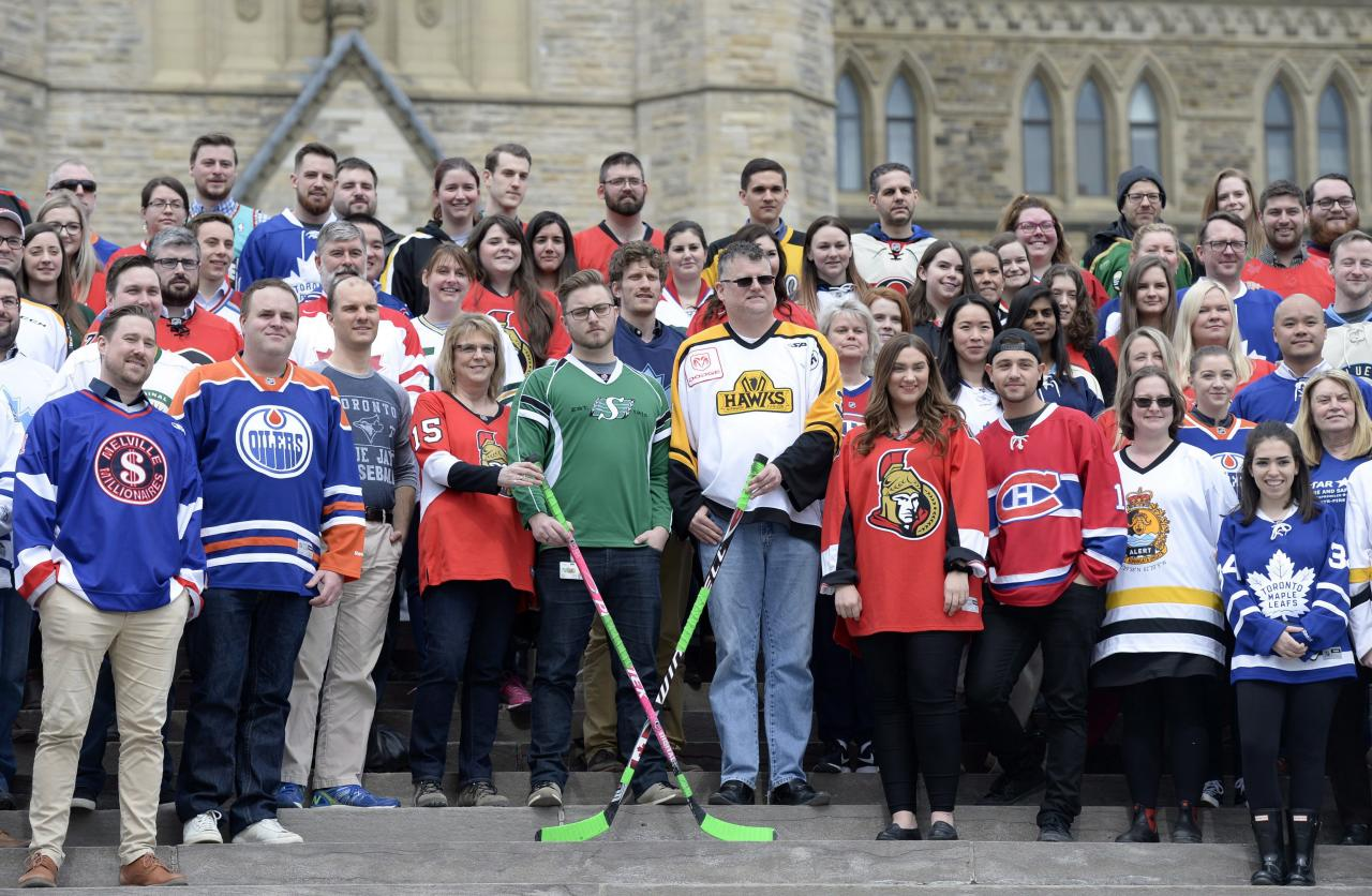 <p>Conservative Party of Canada staffers wearing sports jerseys in tribute to the victims of the Humboldt Broncos bus crash gather for a group photo on the steps of Parliament Hill, in Ottawa on Thursday, April 12, 2018.<br />(Photo by Justin Tang, The Canadian Press) </p>
