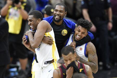 Jun 8, 2018; Cleveland, OH, USA; Golden State Warriors forward Kevin Durant (middle) celebrates with forward Kevon Looney (left) an guard Nick Young (right) after defeating the Cleveland Cavaliers in game four of the 2018 NBA Finals at Quicken Loans Arena. Mandatory Credit: David Richard-USA TODAY Sports
