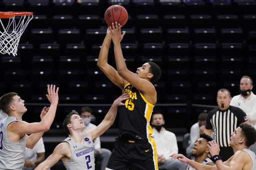 Iowa forward Keegan Murray, center, goes up for a shot against Northwestern during the first half of an NCAA college basketball game in Evanston, Ill., Sunday, Jan. 17, 2021. (AP Photo/Nam Y. Huh)