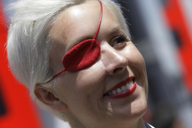 FILE - Spanish former F1 driver Maria De Villota smiles in the paddock prior to the start of qualifying session at the Catalunya racetrack in Montmelo, near Barcelona, Spain, in this May 11, 2013 file photo. Spanish police have confirmed Friday Oct. 11, 2013 that racing driver Maria de Villota has been found dead in a hotel room in Seville, and say it appears she died of natural causes. She was 33. De Villota was seriously injured last year in a crash during testing for the Marussia Formula One team, losing her right eye and sustaining other serious head injuries. (AP Photo/Luca Bruno)