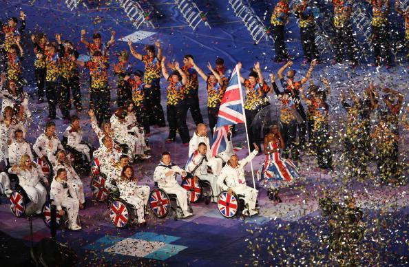 LONDON, ENGLAND - AUGUST 29: Wheelchair tennis player Peter Norfolk of Great Britain carries the flag during the Opening Ceremony of the London 2012 Paralympics at the Olympic Stadium on August 29, 2012 in London, England. (Photo by Scott Heavey/Getty Images)