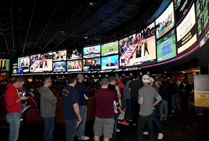 "Guests line up to place bets at the Westgate Las Vegas resort and casino in Las Vegas. <span class=""copyright"">(Ethan Miller / Getty Images)</span>"