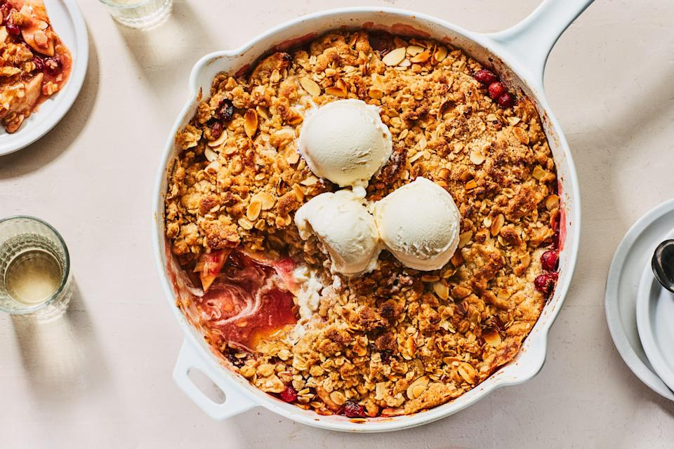 """What's easier than pie? Crisp. Tangy cranberries and sweet orange zest add a floral tartness to this apple version, which is topped with an almond-studded, oatmeal-cookie crumble. <a href=""""https://www.epicurious.com/recipes/food/views/apple-cranberry-crisp-with-oatmeal-cookie-crumble?mbid=synd_yahoo_rss"""" rel=""""nofollow noopener"""" target=""""_blank"""" data-ylk=""""slk:See recipe."""" class=""""link rapid-noclick-resp"""">See recipe.</a>"""