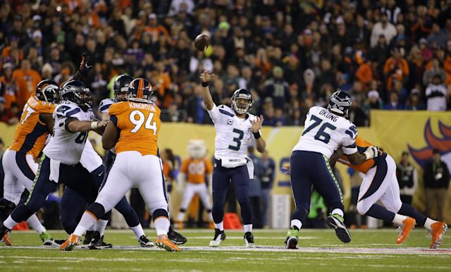 Seattle Seahawks quarterback Russell Wilson (3) throws a pass during the first half of the NFL Super Bowl XLVIII football game against the Denver Broncos Sunday, Feb. 2, 2014, in East Rutherford, N.J. (AP Photo/Matt Slocum)
