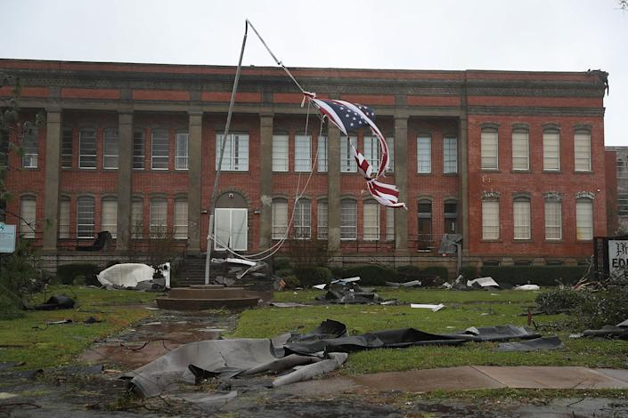 An American flag flies from a broken flag pole after Hurricane Michael passed through the downtown area of Panama City.