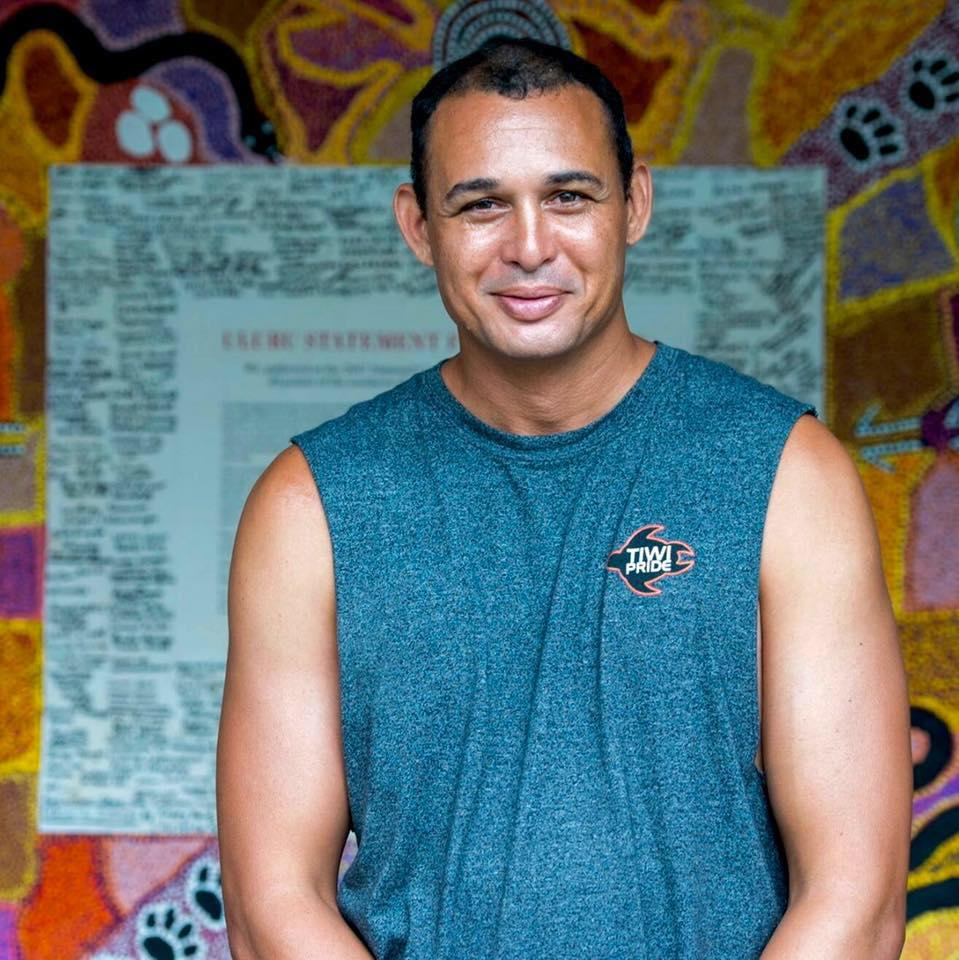Author Thomas Mayor pictured in front of the Uluru Statement from the Heart canvas. Photo: Martin Ollman