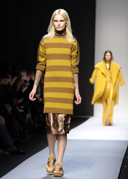 A model wears a creation for Max Mara women's Fall-Winter 2013-14 collection, part of the Milan Fashion Week, unveiled in Milan, Italy, Thursday, Feb. 21, 2013. (AP Photo/Giuseppe Aresu)
