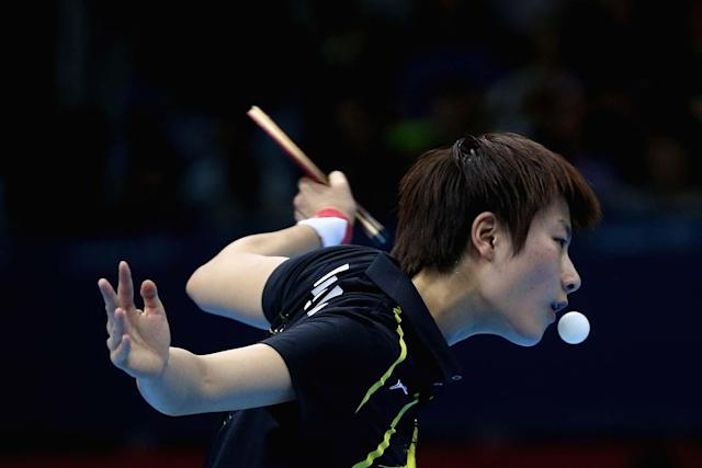 LONDON, ENGLAND - JULY 31: Ning Ding of China completes during the Women's Singles Table Tennis quarter-final match against Ai Fukuhara of Japan on Day 4 of the London 2012 Olympic Games at ExCeL on July 31, 2012 in London, England. (Photo by Feng Li/Getty Images)