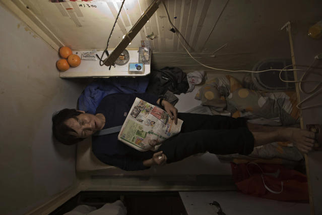 "<p>In this Thursday, March 28, 2017 photo, a resident who only gave his surname Yeung, takes rest in his ""coffin home"" in Hong Kong. In wealthy Hong Kong, there's a dark side to a housing boom, with hundreds of thousands of people forced to live in partitioned shoebox apartments, or ""coffin homes,"" and other types of inadequate housing. (Photo: Kin Cheung/AP) </p>"