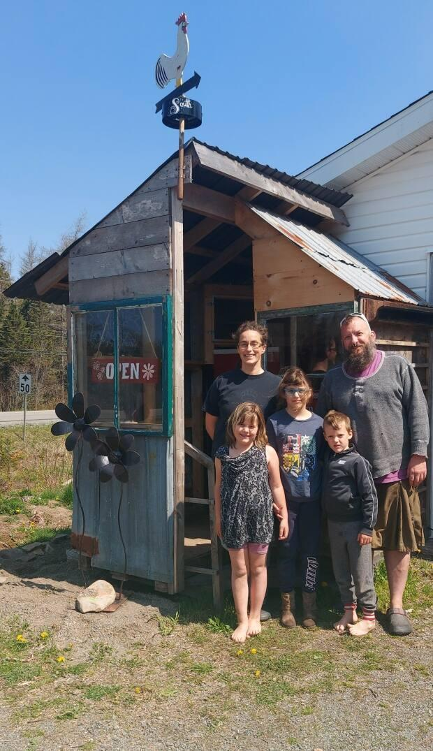 Carmen and Nathan Sampson and their children are shown outside their farmstand in Sampsonville, Richmond County.  (Submitted by Carmen Sampson - image credit)