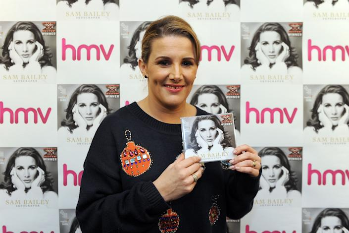 X Factor winner Sam Bailey with a copy of her new single at an HMV Store in Leicester.