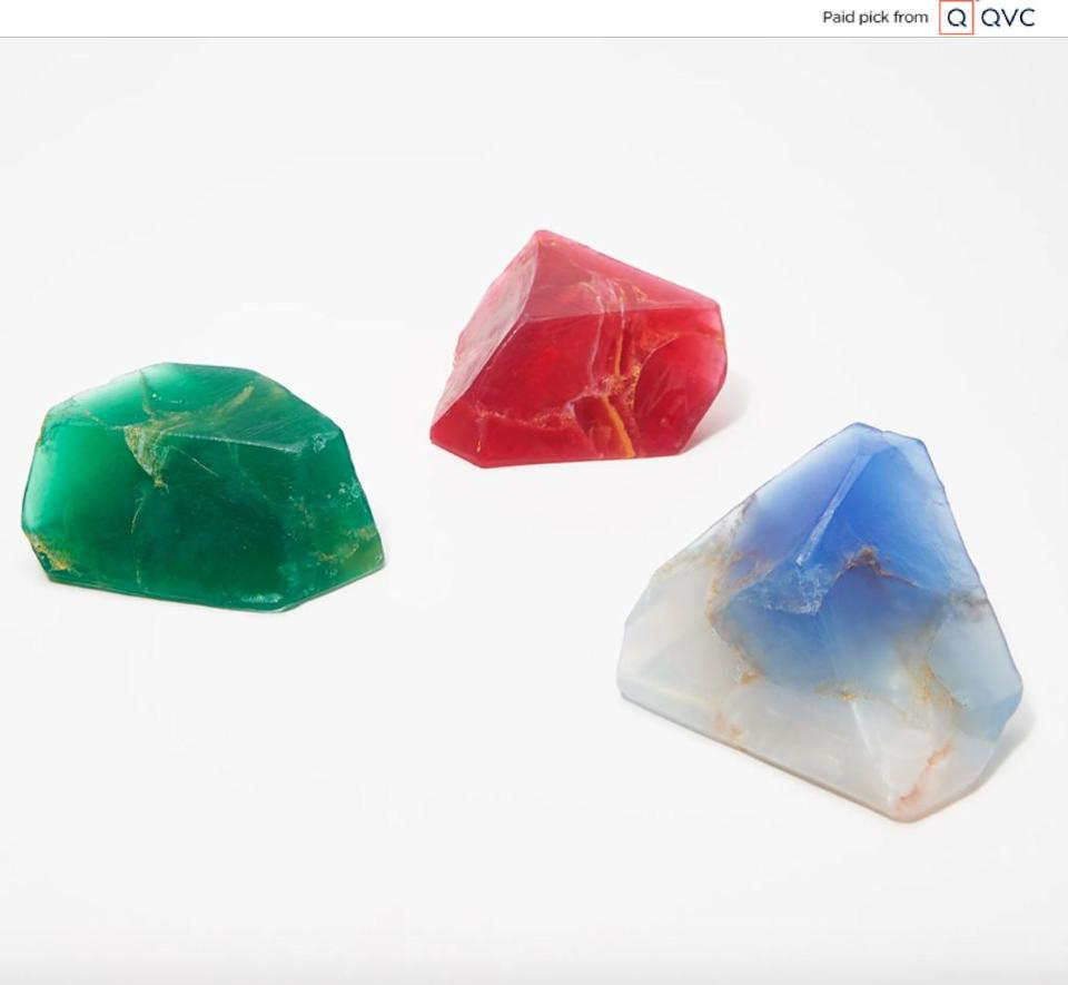 """If there's someone on your list who can't have enough crystals, the three soaps in this set are shaped like gemstones and come in sapphire, ruby and emerald colors. These soaps also are holiday-themed with scents like balsam fir, """"alpine fresh,""""cranberry and apple. <a href=""""qvc.uikc.net/Ok4KP"""" target=""""_blank"""" rel=""""noopener noreferrer"""">Find it for $24 at QVC</a>."""