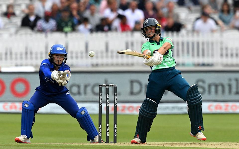 Alice Capsey of Oval Invincibles Women plays a shot as London Spirit Women wicket keeper Amara Carr looks on during The Hundred match between London Spirit Women and Oval Invincibles Women at Lord's Cricket Ground on July 25, 2021 in London, England. - GETTY IMAGES