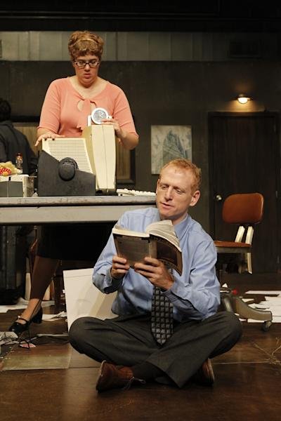 "In this theater image released by The Public Theater, Scott Shepherd is shown in a scene from ""Gatz,"" performing at Martinson Hall in New York. In ""Gatz,"" Shepherd reads aloud almost the entire book in an insanely inventive theatrical show that lasts over eight hours, including three breaks. He calls it ""a David Blaine-type endurance stunt-event."" (AP Photo/The Public Theater, Joan Marcus)"