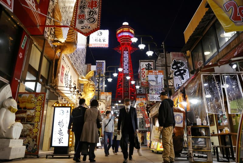 FILE PHOTO: Pedestrians are seen in front of the Tsutenkaku Tower in Osaka