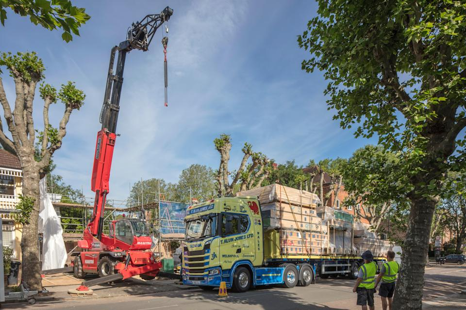 Piece by piece: carpenters in Welshpool created the timber house, which arrived on three lorries this week (Morley von Sternberg)