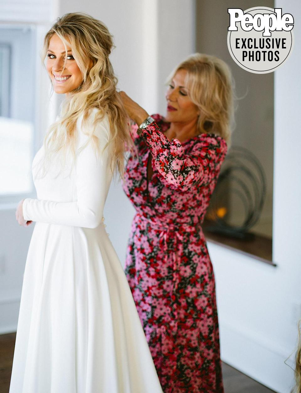 <p>Wayne's mom, actress Aissa Wayne, helped the bride-to-be with final touches ahead of the ceremony.</p>