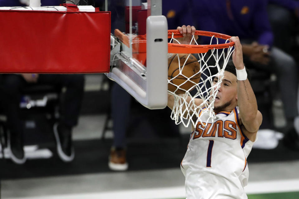 Phoenix Suns Devin Booker dunks during the second half of an NBA basketball game against the Milwaukee Bucks Monday, April 19, 2021, in Milwaukee. (AP Photo/Aaron Gash)