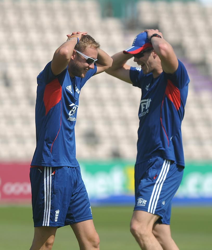 SOUTHAMPTON, ENGLAND - AUGUST 27: Stuart Broad (L) and Boyd Rankin of England joke around during the warm up during the England Nets Session at The Ageas Bowl on August 27, 2013 in Southampton, England. (Photo by Charlie Crowhurst/Getty Images)
