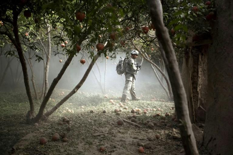 A US soldier on patrol in a pomegranate orchard in Jellawar. Only 2,500 US troops will remain in AFghanistan from January 2021