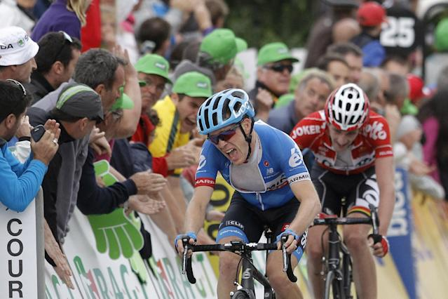 Garmin's Andrew Talansky of USA, winner of the 66th Dauphine cycling race, reacts as he crosses the finish line of the last stage, in Courchevel, French Alps, Sunday, June 15, 2014. (AP Photo/Laurent Cipriani)