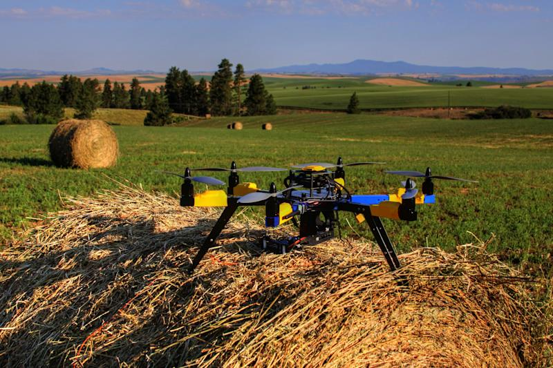 In this July 2013, photo provided by Robert Blair, shows a multi-rotor hexacopter, an unmanned aircraft that Blair purchased to monitor his farm in Kendrick, Idaho. Experts say agriculture is the most promising commercial market for drones, the technology a perfect fit for America's large-scale farms and vast rural areas where privacy and safety issues are less of a concern. (AP Photo/Courtesy of Robert Blair).