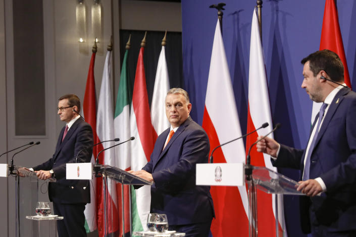 Hungarian prime minister Viktor Orban, center, Poland's prime minister, Matteusz Morawiecki, left, and former interior minister of Italy, Matteo Salvini attend a joint press conference in Budapest, Hungary, Thursday, April 1, 2021. Hungarian prime minister Viktor Orban hosted talks with right-wing politicians, Poland's prime minister, Matteusz Morawiecki, and former interior minister of Italy, Matteo Salvini, a potential opening step toward a new populist political force on the European stage. (AP Photo/Laszlo Balogh)