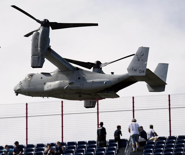 <p>Fans watch as an Osprey helicopter flies by before an NFL football game between the Tennessee Titans and the Minnesota Vikings Sunday, Sept. 11, 2016, in Nashville, Tenn. The helicopter is to be part of the 9/11 tribute at the game. (AP Photo/Mark Zaleski) </p>