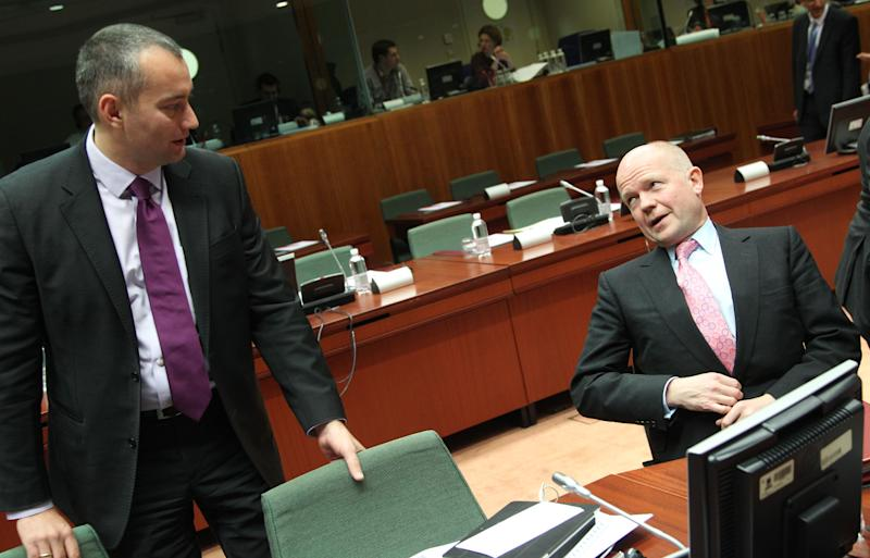 British Foreign Secretary William Hague, right, talks with Bulgarian Foreign Minister Nikolay Mladenov, during the EU foreign ministers meeting at the European Council building in Brussels, Monday, Nov. 19, 2012. The European Union's foreign policy chief is expressing concern about the mounting death toll in the Gaza conflict, saying the crisis can only be resolved with a long-term solution. (AP Photo/Yves Logghe)
