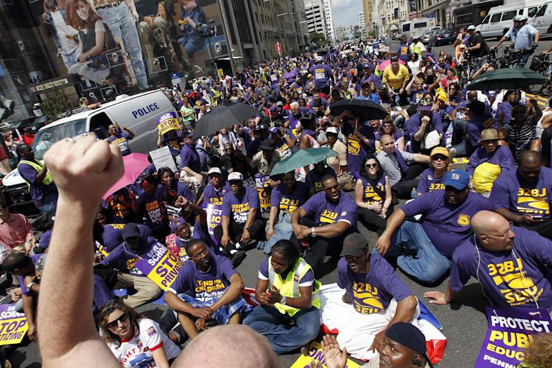 Protestors chant as they sit in Broad Street in an ac of civil disobedience during a protest of Pennsylvania Gov. Tom Corbett's proposed cuts to the education budget Wednesday, May 23, 2012 in Philadelphia. (AP Photo/Alex Brandon)