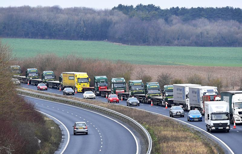 """A line of lorries is seen during a trial between disused Manston Airport and the Port of Dover of how road will cope in case of a """"no-deal"""" Brexit, Kent, Britain January 7, 2019. REUTERS/Toby Melville"""