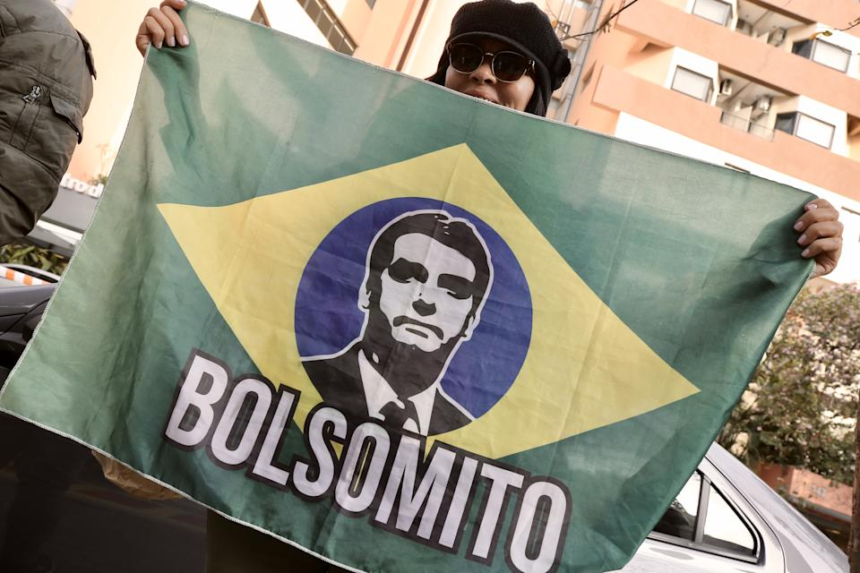 SAO PAULO, BRAZIL - JULY 16: Supporters of Brazilâs President Jair Bolsonaro gather in front of the Vila Nova Star hospital in Sao Paulo, Brazil, on July 16, 2021. Bolsonaro has been hospitalized since Wednesday 14 to treat intestinal problems and his condition has been evolving satisfactorily. (Photo by Paulo Lopes/Anadolu Agency via Getty Images)