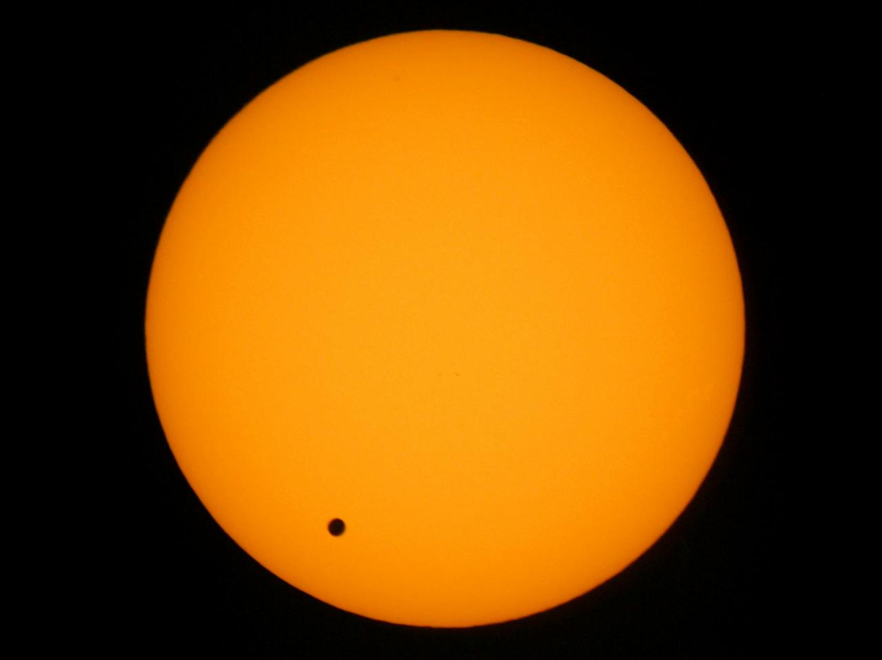 Venus transits across the sun as seen over Hong Kong June 8, 2004. The transit of Venus, when the planet drifts across the face of the Sun as it travels between the Sun and the Earth, is so rare that no living being has ever witnessed the celestial event. Five transits of Venus have been recorded - the last occured in 1882. REUTERS/Bobby Yip REUTERS  BY/SH
