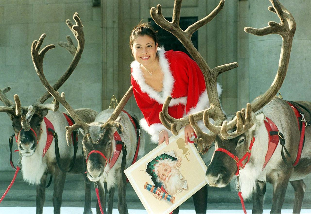 Manchester's Boddingtons beer model and Big Breakfast presenter Melanie Sykes launches the Royal Mail's Christmas stamps at a photocall with reindeer in London, today (Sunday).  Photo by Rebecca Naden /PA.   (Photo by Rebecca Naden - PA Images/PA Images via Getty Images)