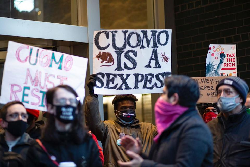 People attend a protest to demand New York Governor Andrew Cuomo's resignation.