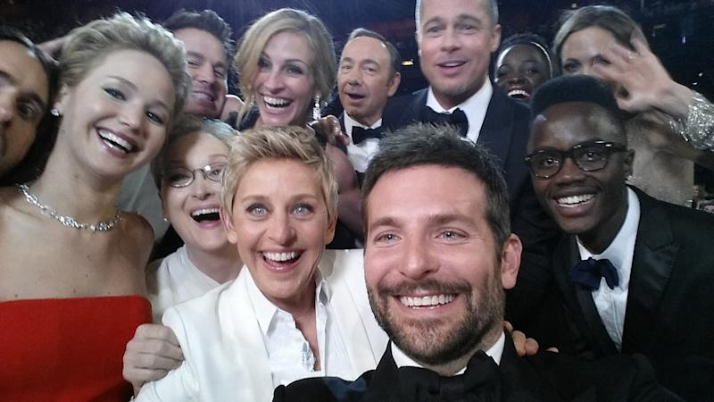 Ellen DeGeneres, host Ellen DeGeneres poses for a selfie taken by Bradley Cooper with (clockwise from L-R) Jared Leto, Jennifer Lawrence, Channing Tatum, Meryl Streep, Julia Roberts, Kevin Spacey, Brad Pitt, Lupita Nyong'o, Angelina Jolie, Peter Nyong'o Jr. and Bradley Cooper during the 86th Annual Academy Awards at the Dolby Theatre on March 2, 2014 in Hollywood, California
