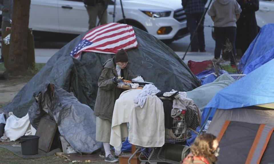 A woman at Echo Park homeless encampment in Los Angeles. California has more people who are homeless than any other state.