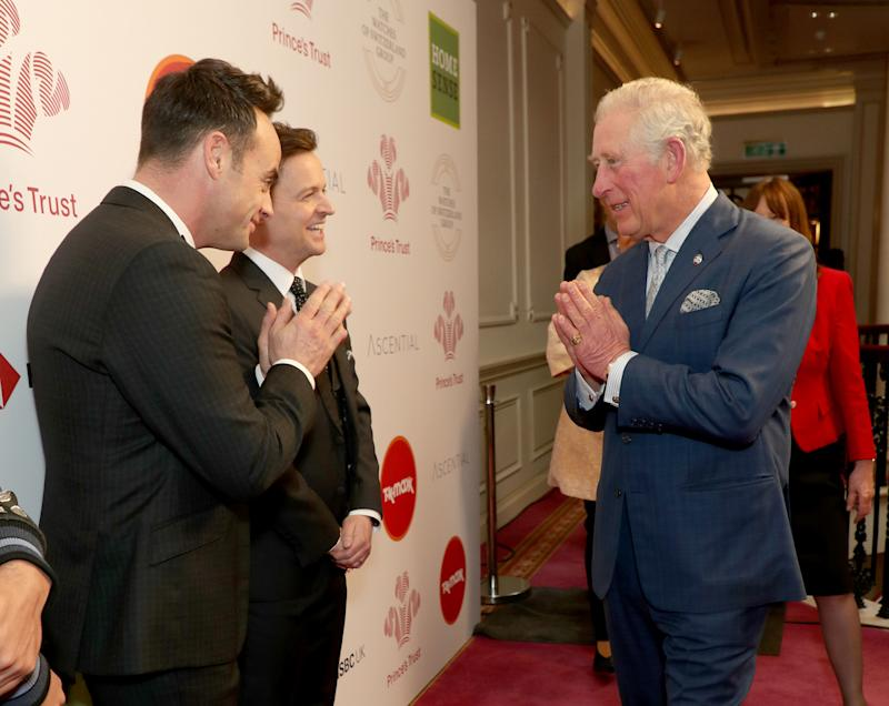LONDON, ENGLAND - MARCH 11: Prince Charles, Prince of Wales uses the Namaste gesture to greet television presenters Ant McPartlin (L) and Declan Donnelly as he attends the Prince's Trust And TK Maxx & Homesense Awards at London Palladium on March 11, 2020 in London, England. (Photo by Yui Mok - WPA Pool/Getty Images)