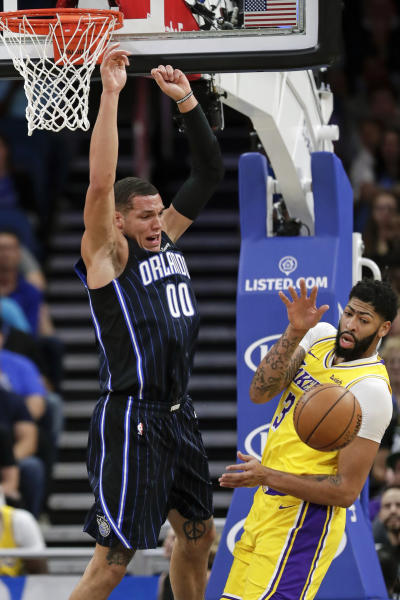 Orlando Magic's Aaron Gordon (00) loses the ball as he goes up for a shot against Los Angeles Lakers' Anthony Davis, right, during the first half of an NBA basketball game, Wednesday, Dec. 11, 2019, in Orlando, Fla. (AP Photo/John Raoux)