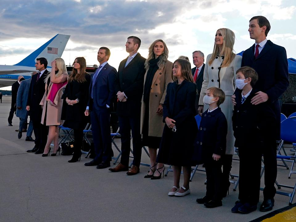 Members of Donald Trump's family including senior advisors Ivanka Trump and Jared Kushner stand on the tarmac at Joint Base Andrews in Maryland as they arrive for US President Donald Trump's departure ceremonyAFP via Getty Images