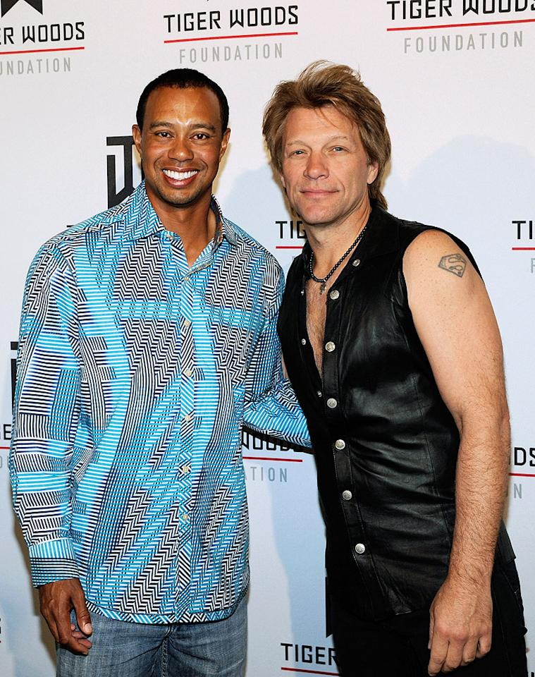 What's worse, Tiger Woods' seizure-inducing button down, or the fact that Jon Bon Jovi (despite looking hot for 50) still thinks he can pull off the whole sleeveless leather vest thing? Discuss! (4/28/2012)
