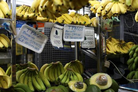 Information for Vippo app and other methods of payment is seen in a fruit and vegetables stall at Chacao Municipal Market in Caracas, Venezuela January 19, 2018. Picture taken January 19, 2018. REUTERS/Marco Bello